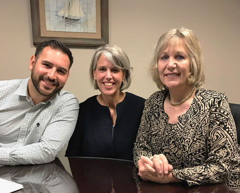 Board member Isaac Figueroa, who handled the transaction, Head of School The Rev. Anne Sawyer, and Board President Dr. Jan Brundage prepare to finalize the purchase on April 19, 2017